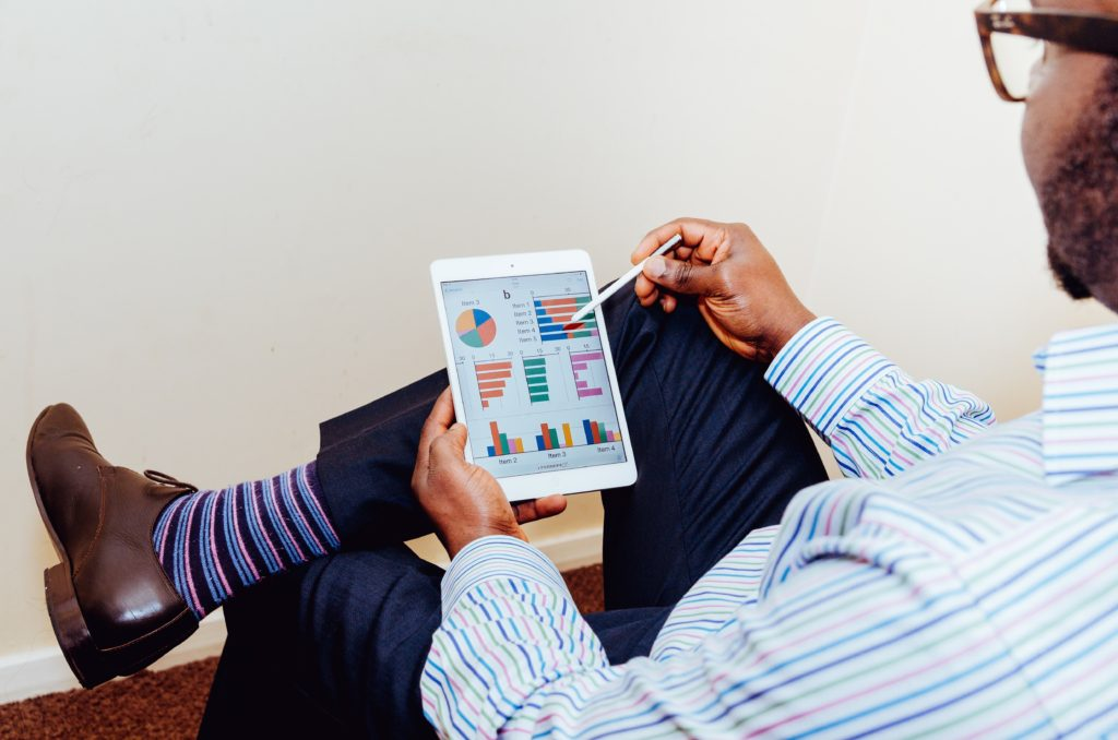 man tablet data analytics